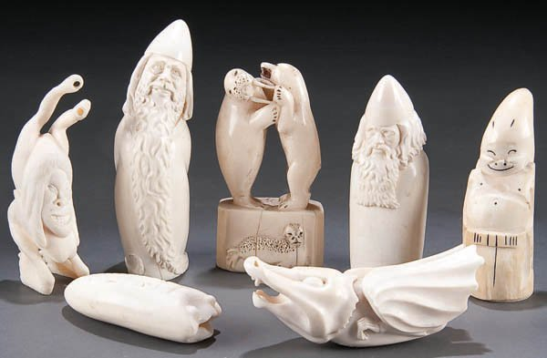 1045: A GROUP OF CARVED IVORY INUIT OR ALASKAN FIGURES