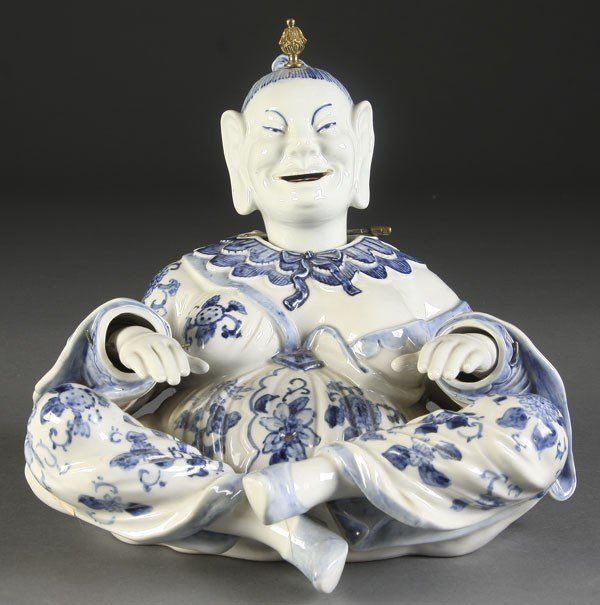 41: A CHINESE DECORATED PORCELAIN NODDER