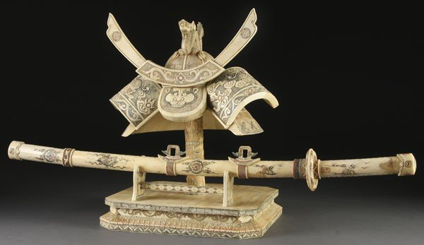 213: ORIENTAL CARVED BONE MODEL OF SAMURAI HELMET
