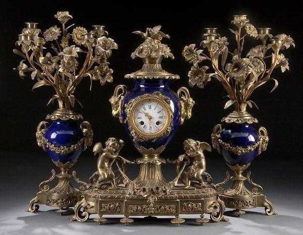 A FRENCH GILT BRONZE CLOCK GARNITURE