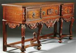 438: A FINE JACOBEAN REVIVAL STYLE WALNUT DINING ROOM
