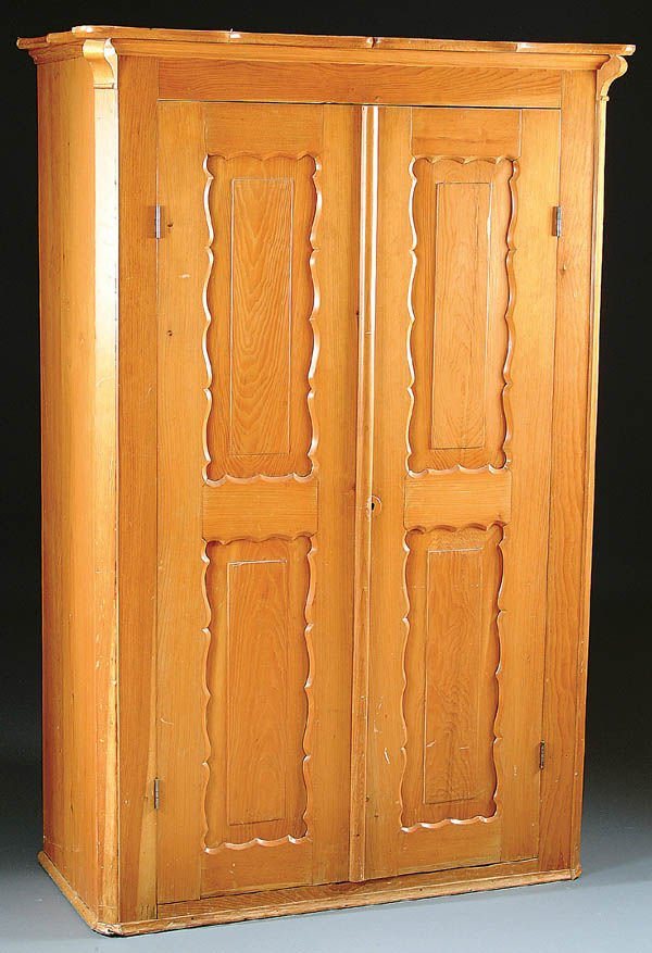 387: A COUNTRY PINE WARDROBE, circa 1860, with paneled