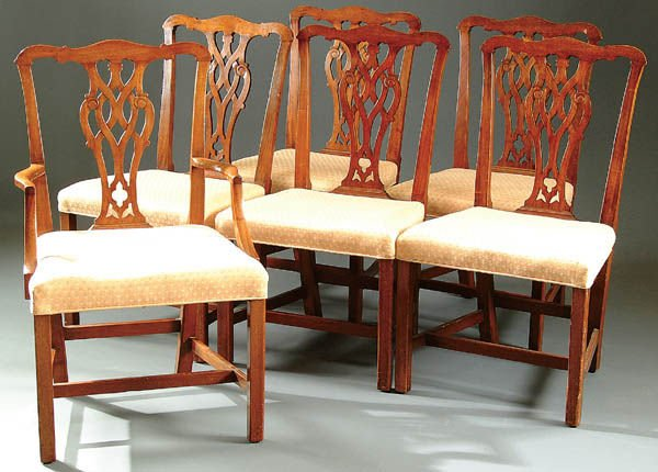 375: A SET OF CHIPPENDALE-STYLE MAHOGANY DINING CHAIRS