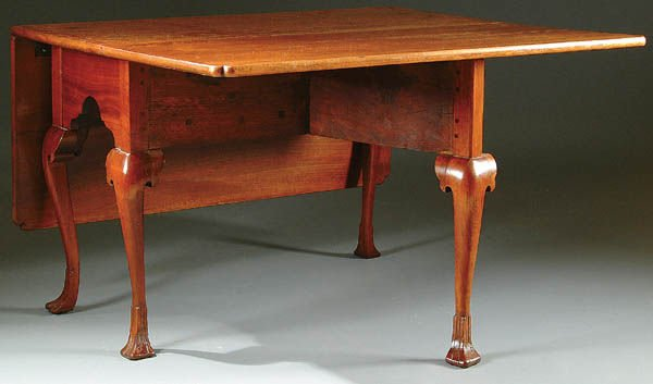 369: A VERY FINE WALNUT DINING TABLE, AMERICAN QUEEN A