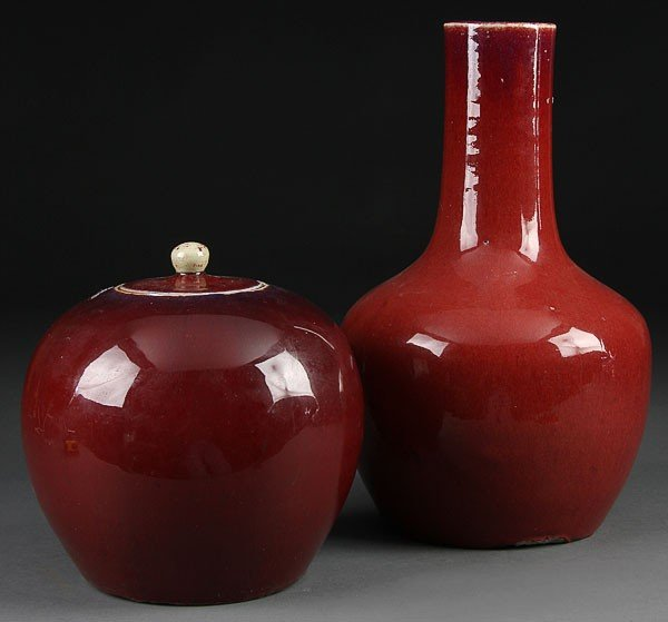 18: A CHINESE RED GLAZED VASE AND LIDDED JAR