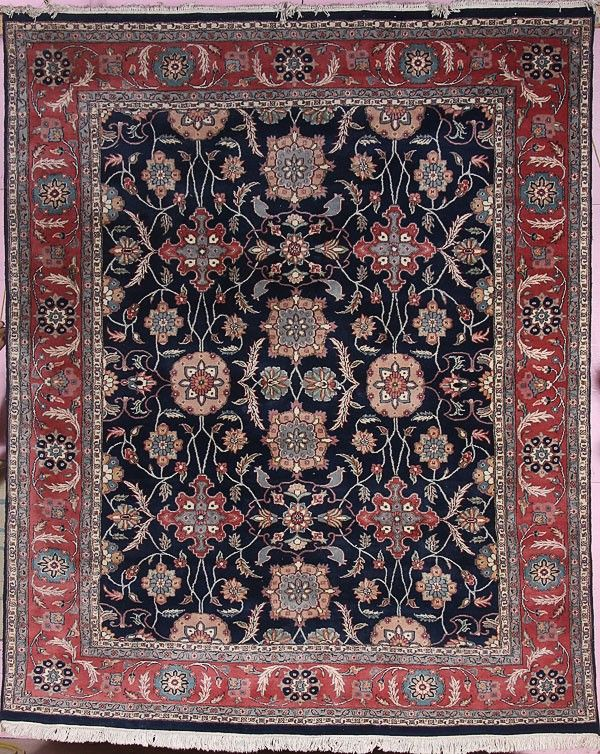 A LARGE ROOM SIZED HAND WOVEN ORIENTAL CARPET, wi