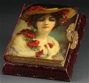 1099: A VERY FINE VICTORIAN CELLULOID AND MUSIC BOX PHO