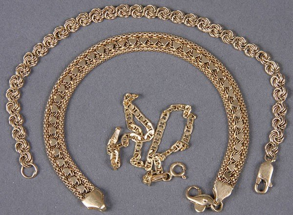 659B: THREE 14KT YELLOW GOLD BRACELETS