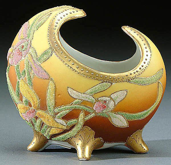 22: A NIPPON CORALENE DECORATED FOOTED VASE circa 190