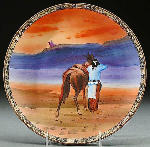 115: A NIPPON INDIAN SHOOTING PORCELAIN PLAQUE circa 1