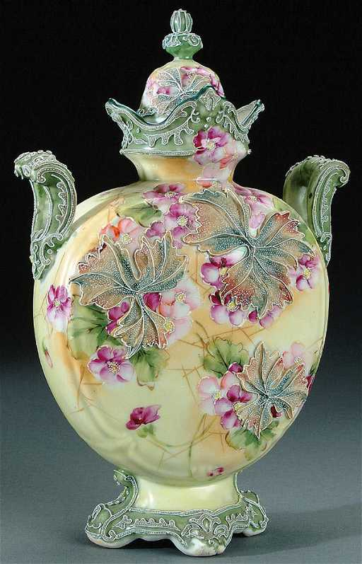 216 A Nippon Moriage Decorated Porcelain Covered Urn