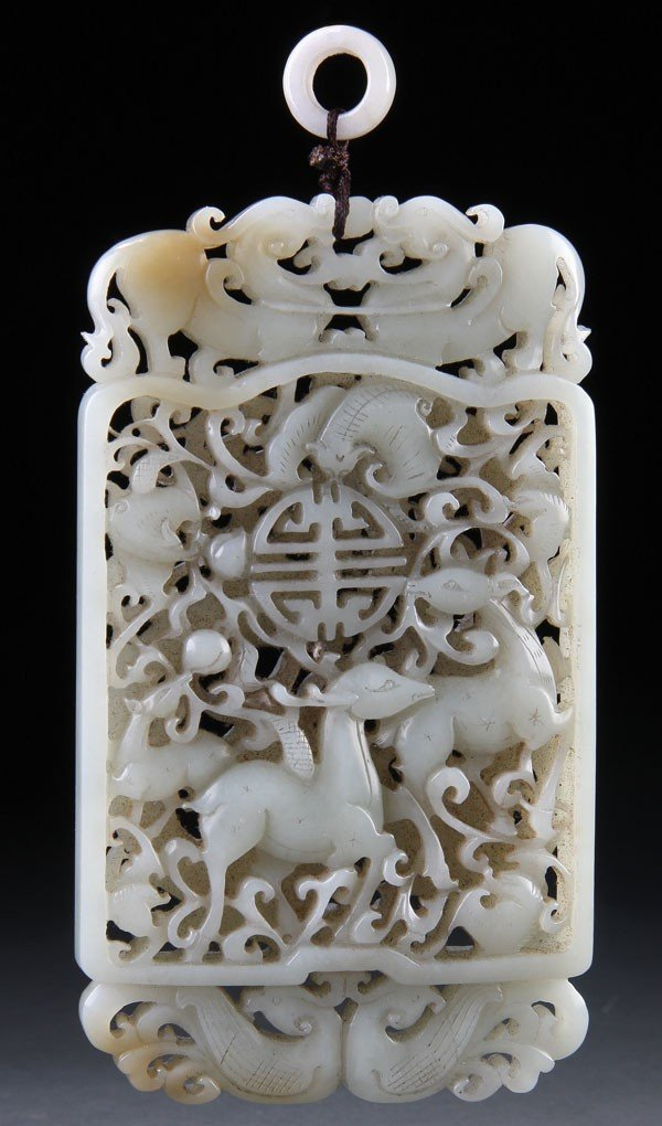 450: A  CHINESE CARVED WHITE JADE ORNAMENTAL PLAQUE