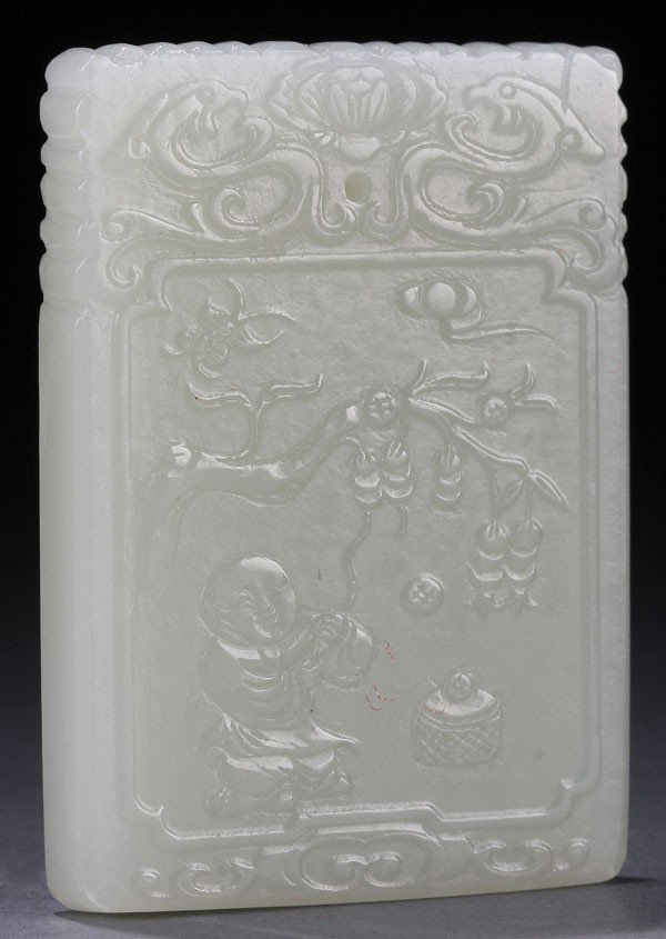 453: A CHINESE CARVED WHITE JADE PENDANT PLAQUE.