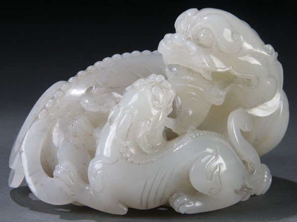 461: A GOOD CHINESE CARVED WHITE JADE FIGURAL KYLIN