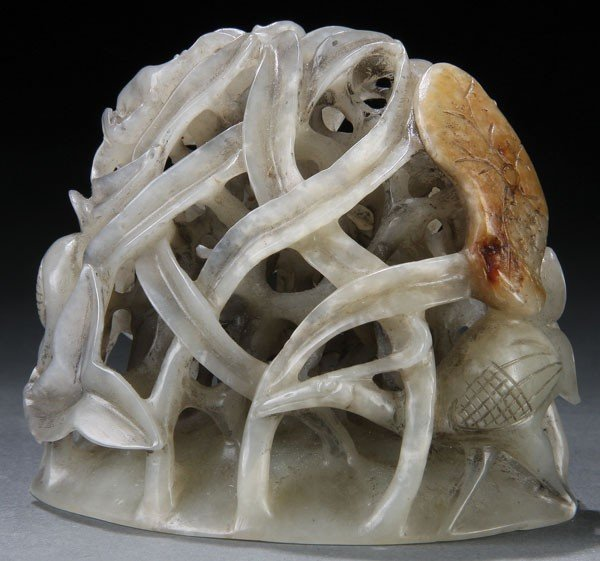 462: A CHINESE CARVED WHITE JADE AND RUSSET FINIAL