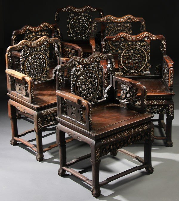 702:  SIX CHINESE EXPORT CARVED ROSEWOOD ARMCHAIRS