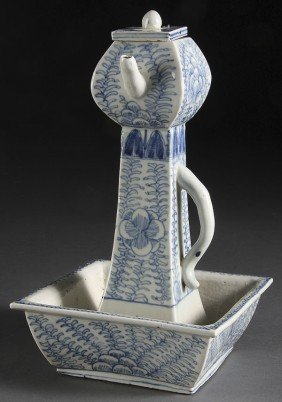 A CHINESE BLUE AND WHITE OIL LAMP