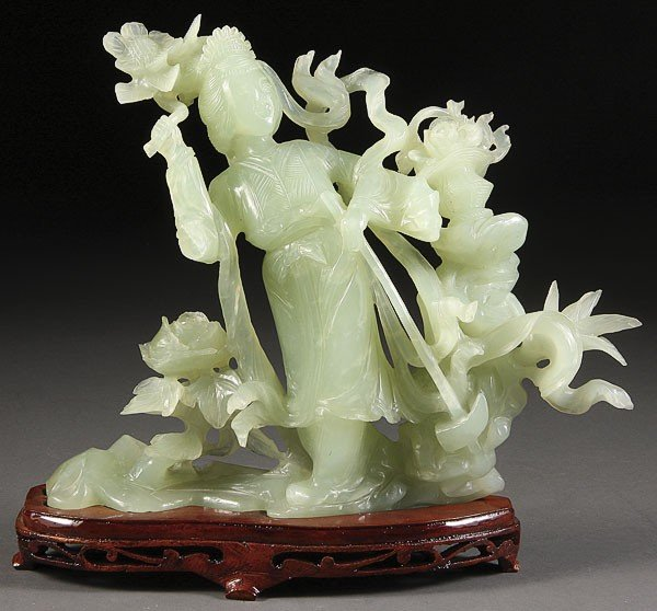 69: CHINESE CARVED SERPENTINE (HARDSTONE) GUANYIN