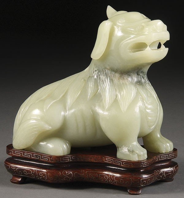 72: A CHINESE CARVED JADE FIGURE OF A MYTHICAL BEAST,