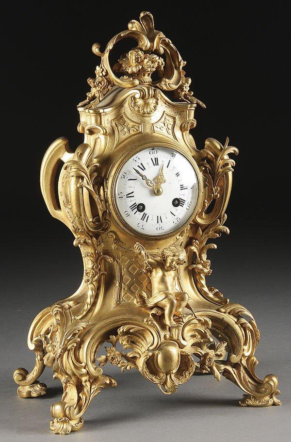 558: A FRENCH LOUIS XVI STYLE GILT BRONZE MANTLE CLOCK,