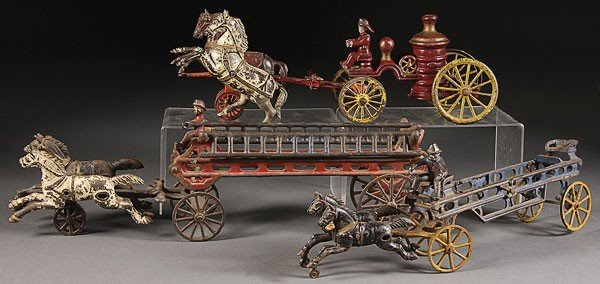 757: THREE CAST IRON TOY HORSE DRAWN FIRE WAGONS