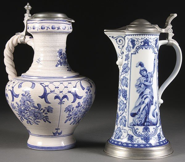 1063: A LARGE DELFT HAND PAINTED POTTERY JUG