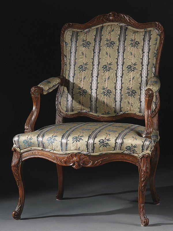 676: LOUIS XVI STYLE CARVED ARM CHAIR