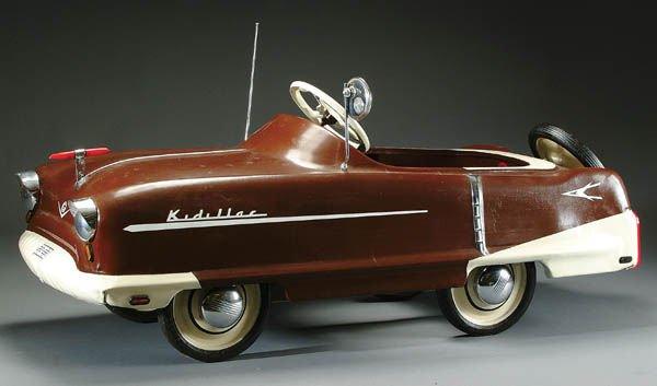 6: A GARTON TOY CO. MODEL KIDILLAC PEDAL CAR pressed