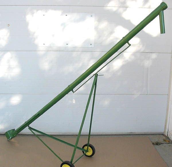 56: A PEDAL SCALE GRAIN AUGER in John Deere green, ci