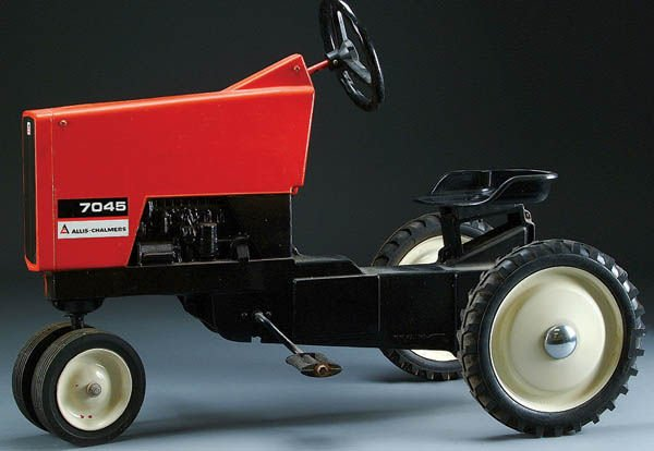 64: AN ALLIS CHALMERS MODEL 7045 PEDAL TRACTOR circa