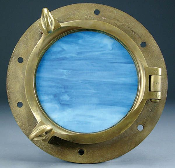 293: A BRASS SHIPS PORTHOLE early 20th century with bl