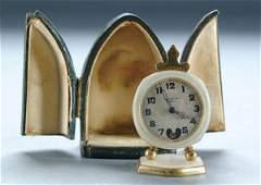1286: A MINIATURE SWISS TRAVEL CLOCK circa 1900, bronze