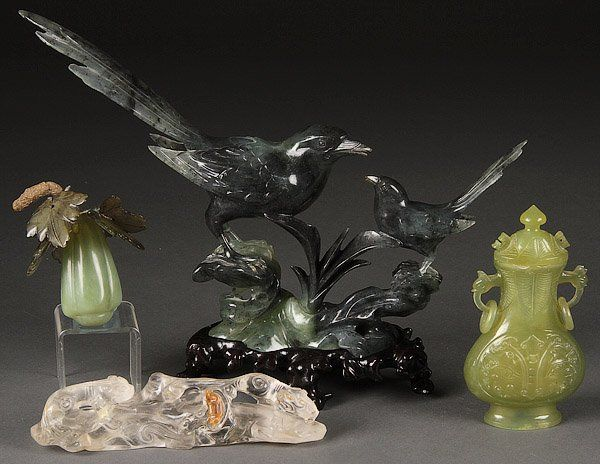 A CHINESE CARVED JADE AND ROCK CRYSTAL GROUP