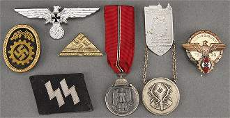 A GERMAN WWII INSIGNIA AND BADGE LOT