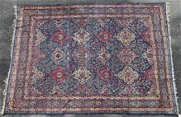 A HAND WOVEN ORIENTAL ROOM SIZE CARPET