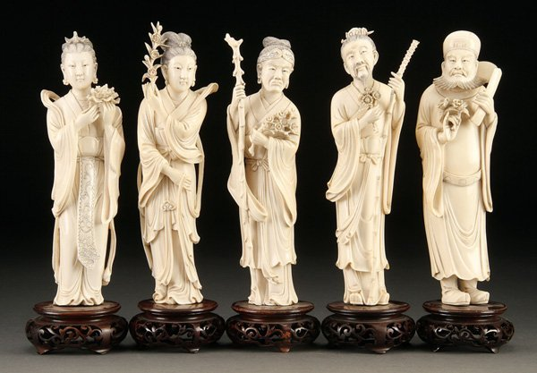 1037: A GROUP OF FIVE CHINESE CARVED IVORY IMMORTALS