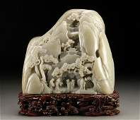 1046: A LARGE CHINESE CARVED JADE MOUNTAIN/BOULDER