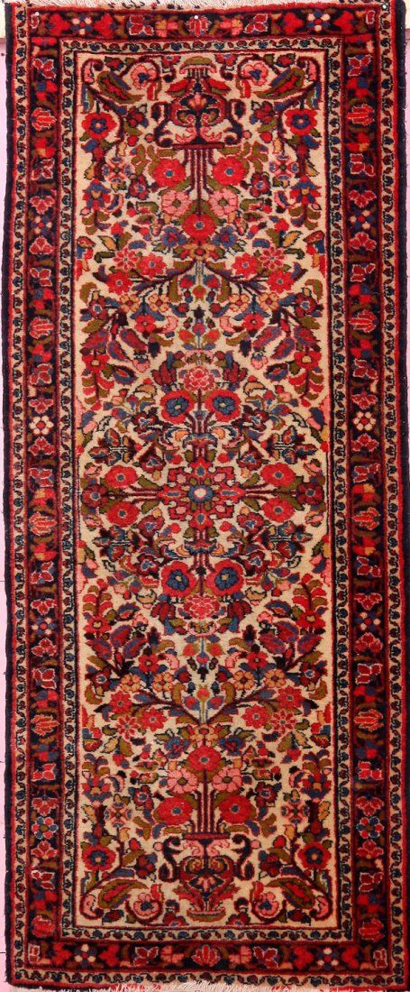 A PERSIAN HAND WOVEN ORIENTAL RUG