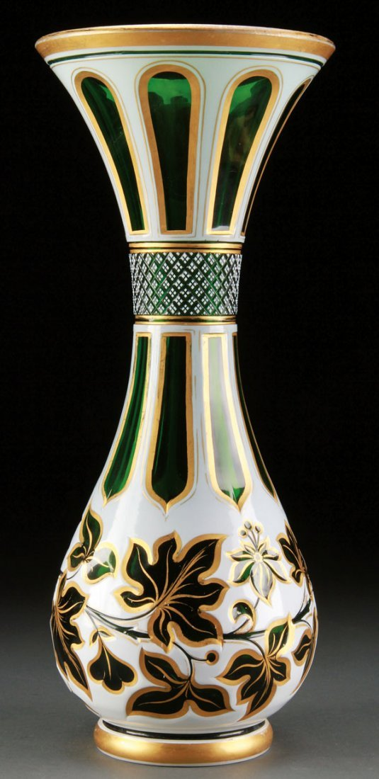 BOHEMIAN CUT OVERLAY AND GILT DECORATED VASE