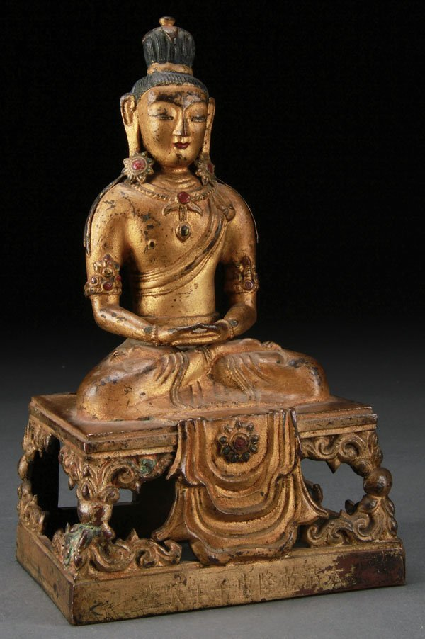 A SINO-TIBETAN GILT-COPPER FIGURE OF AMITAYUS
