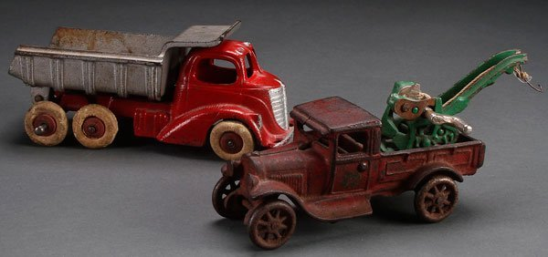 AN ARCADE CAST IRON WRECKER AND HUBLEY TOY GROUP