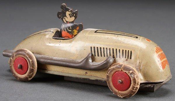 A SCARCE 1936 MICKEY MOUSE RACE CAR TIN WIND UP.