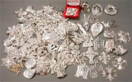 A GROUP OF 140 STERLING CHRISTMAS ORNAMENTS
