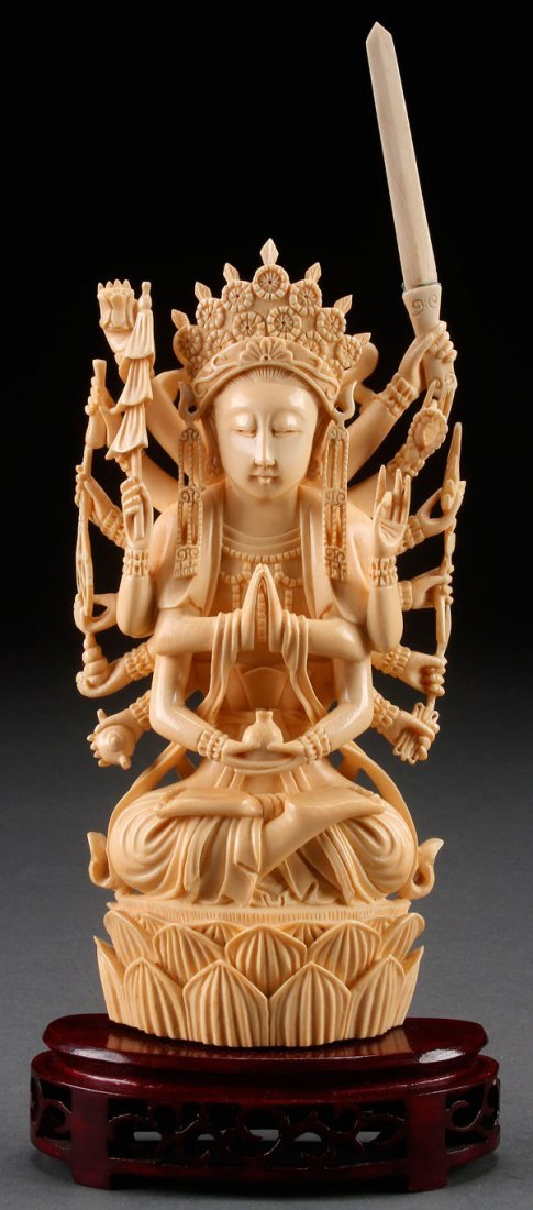 A FINE CHINESE CARVED IVORY FIGURE OF GUAN YIN