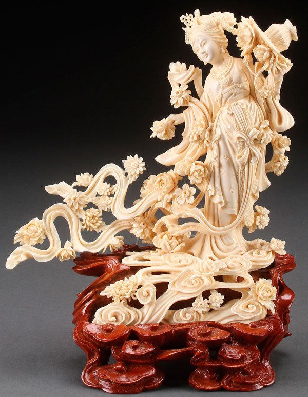 A LARGE CHINESE CARVED IVORY GUAN YIN