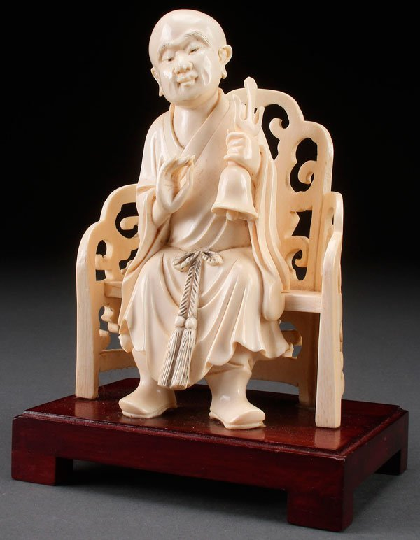 A FINE CHINESE CARVED IVORY BUDDHIST FIGURE