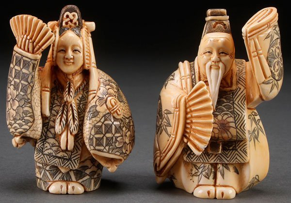 A VERY FINE PAIR OF JAPANESE CARVED IVORY FIGURES