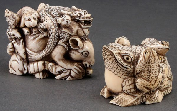 A PAIR OF JAPANESE CARVED IVORY OKIMONOS