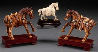 A FINE PAIR OF CHINESE CARVED IVORY AND JEWELED HORSES