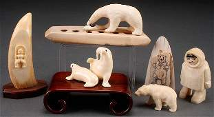 A GROUP OF FIVE ESKIMO AND ALEUTIAN CARVED IVORY